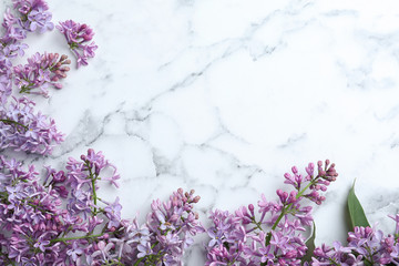 Wall Murals Lilac Blossoming lilac flowers on marble table, flat lay. Space for text