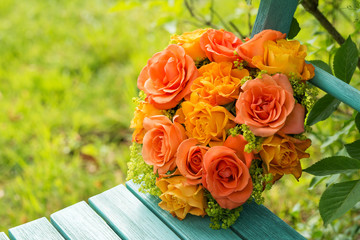 Roses flower arrangement on a garden chair