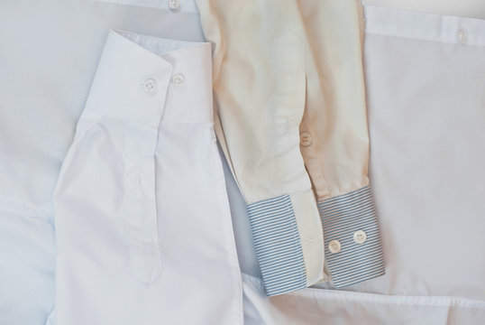 Clean and dirty shirt together. Two white shirts in one shot. The concept of washing and bleaching clothes. The contrast between the new and the old shirt.