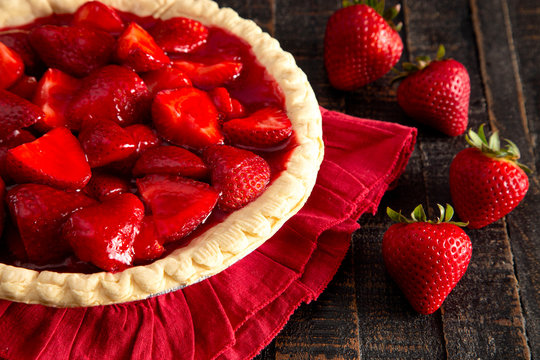 A Fresh Strawberry Pie on a Distressed Wooden Table