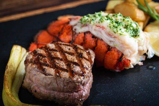 surf and turf on black stone plate