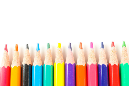 Many color pencils isolated on white background