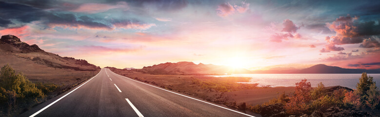 Road Trip - Scenic Landscape With Highway At Sunrise Wall mural