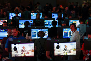 Gamers play Borderlands 3 by 2K at E3, the annual video games expo experience the latest in gaming software and hardware in Los Angeles