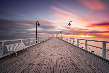 Wooden pier in Gdynia Orlowo in the morning with colors of sunrise. Poland. Europe.