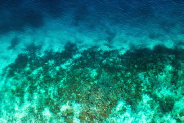Ocean as a background from top view. Turquoise water background from top view. Summer seascape from air. Travel - image