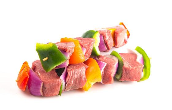 Beef and Veggie Kebabs on a White Background