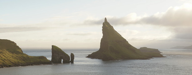 Drangarnir Sea Stack Mountain Hike near Sorvagur during sunset on the Faroe Islands in the Atlantic Ocean. Wall mural
