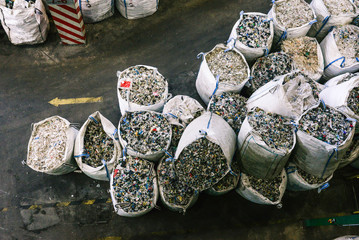 Bags with recycled plastic at a waste sorting plant. Separate garbage collection and sorting. Recycling and recycling plastics