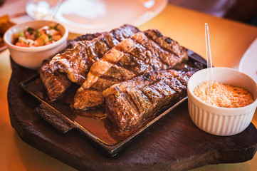 Grilled Picanha, traditional Brazilian beef cut. Meat served on the plate, luxury dinner.
