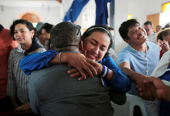 A woman embraces a political prisoner during a religious service for 56 political prisoners, who were released under a new law that frees people who were arrested in recent protests against Nicaraguan President Daniel Ortega's government, in Masaya