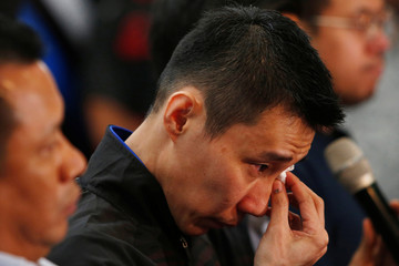 Malaysia's badminton player Lee Chong Wei reacts during a news conference to announce his retirement in Putrajaya