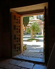Athens Greece, Kaisariani monastery main yard view through chapel's door