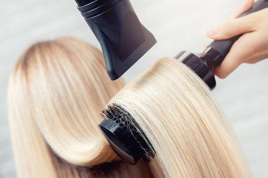 Close-up of hair dryer, concept cut salon, female stylist