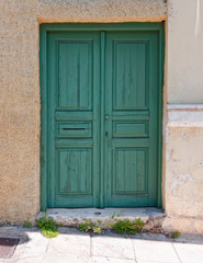 Athens Greece, green door in anafiotika picturesque neighborhood under acropolis