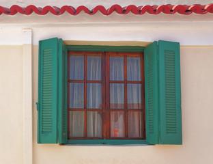 Athens Greece, green shutters window in anafiotika picturesque neighborhood under acropolis