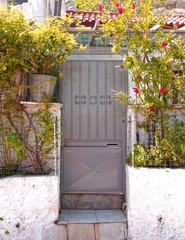 Athens Greece, metallic grey house door in anafiotika picturesque neighborhood under acropolis