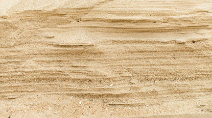 Layers of sand on the beach, soft sandstone at the shore. Abstract background texture Wall mural