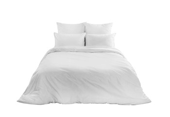 White bedlinen on a white bed isolated. Bedroom with bed and linen. Bed with pillows and duvet...