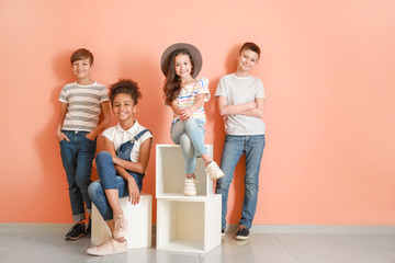 Stylish children in jeans near color wall Wall mural
