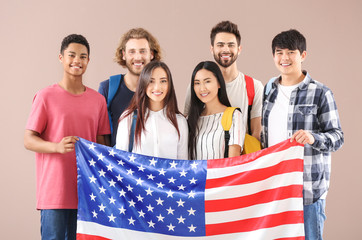 Group of students with USA flag on color background