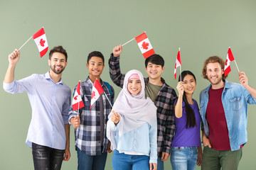 Group of students with Canadian flags on color background Fototapete
