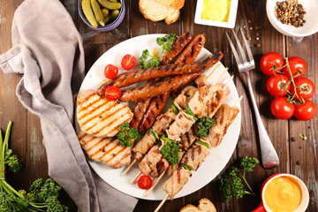 grilled different sort of meat and sauce