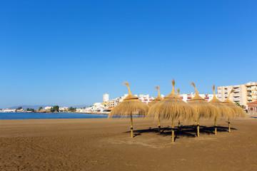 Playa de la Isla one the beaches in Puerto de Mazarron Murcia Spain with parasols and sunshades