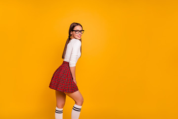 Profile side view portrait of her she nice-looking sweet attractive lovely cheerful girl wearing eyeglasses eyewear uniform posing leisure isolated over bright vivid shine yellow background