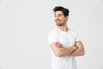 Happy young excited emotional man posing isolated over white wall background.