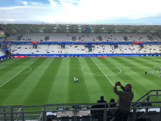A media member photographs an empty stadium hours before the U.S.-Thailand match during the Women's World Cup soccer tournament in Reims