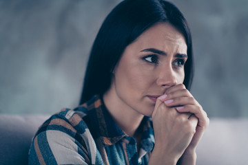 Close up side profile photo beautiful she her lady displeased hopeless hands palms together nerves operation husband hospital clinic wear checkered plaid shirt comfort flat house living room indoors