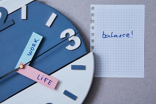 Work life balance choice concept. Clock closeup and arrows telling