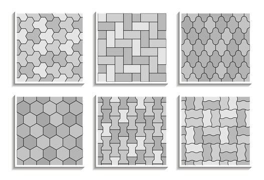 Set of grayscale seamless pavement textures. Black-and-white repeating patterns of street tiles