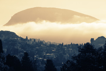 Small town against misty montain