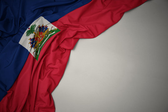 waving national flag of haiti on a gray background.