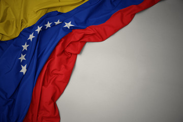 Photo sur Aluminium Amérique du Sud waving national flag of venezuela on a gray background.