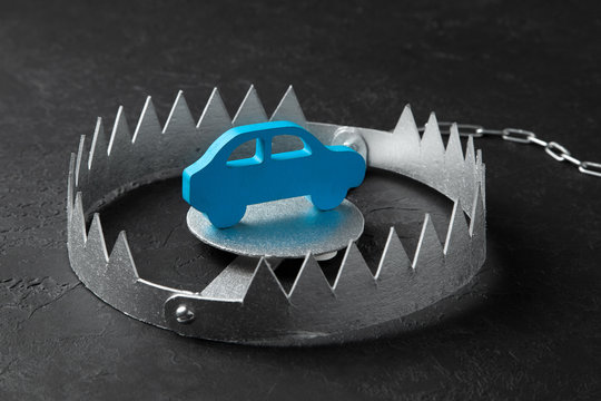 Trap with bait car. The risk of buying bad car. Car insurance. Black background.