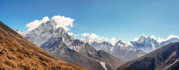Scenic valley and Himalayan mountains peaks on trek between Tengboche and Lobuche, Nepal.