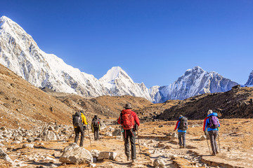 Himalayan mountains peaks and trekkers on the Everest Base Camp trek, Nepal