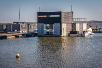 Houseboats for rent on Lake Jamno in Mielno town on the Baltic Sea coast in Poland