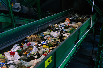 Recycling and sorting of household waste. Distribution by fractions, plastic, glass, cardboard, polyethylene, iron. Sort garbage in the factory
