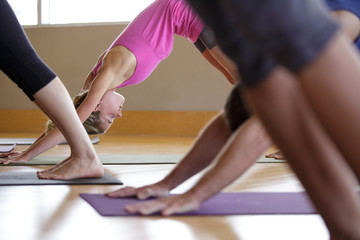 Woman in downward dog pose during yoga class