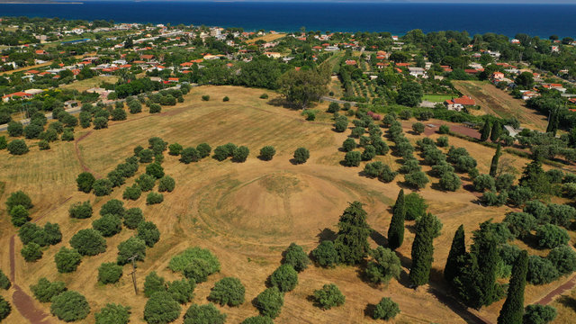 Aerial photo of archaeological site and monument of world famous Marathon tomb in the place of the historical battle between Athenians and Persians in city of Marathonas, Attica, Greece