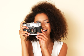 Cheerful model is taking a picture.