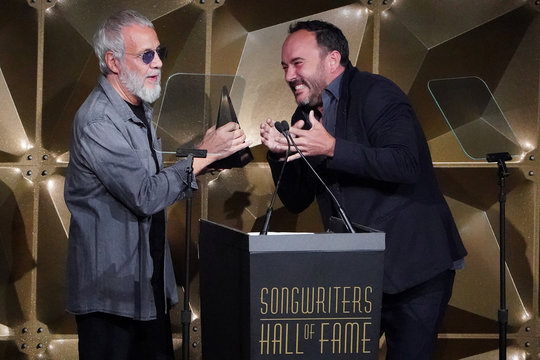 Yusuf Islam receives an award from Dave Matthews during the Songwriters Hall of Fame Inductions in Manhattan