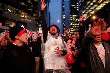 Fans in Jurassic Park watch first quarter action of Toronto Raptors facing the Golden State Warriors in Game Six of the best-of-seven NBA Finals in Toronto