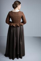 18th century woman in brown ensemble studio backdrop
