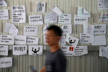Notes are posted on a board following protests against the proposed extradition bill, in Hong Kong, China