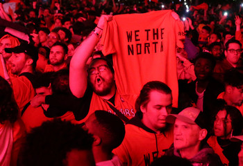 Fans celebrate their win in Game 6 of the NBA basketball Finals between the Toronto Raptors and the Golden State Warriors on a large screen in a fan zone in Montreal